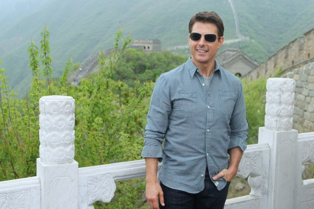 BEIJING, CHINA - MAY 09:  (CHINA OUT, MINIMUM FEES APPLY - 100 USD OR LOCAL EQUIVALENT, PER IMAGE) Actor Tom Cruise poses for photos during a visit to the Great Wall on May 9, 2013 in Beijing, China.  (Photo by ChinaFotoPress/ChinaFotoPress via Getty Images)