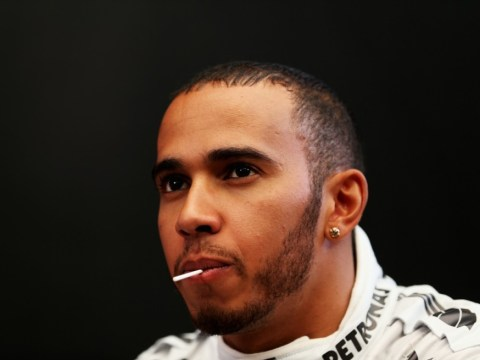 Lewis Hamilton happy to show his puppy love as Roscoe uses paddock pass
