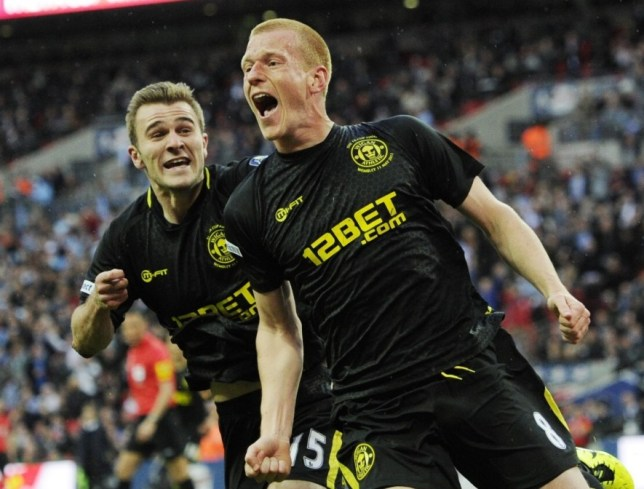 epa03696570 Wigan Athletic's Ben Watson (R) celebrates scoring the winning goal against Manchester City with teammate Callum McManaman during the English FA Cup final soccer match between Manchester City and Wigan Athletic at Wembley Stadium in London, Britain, 11 May 2013.  EPA/TOM HEVEZI DataCo terms and conditions apply. https://www.epa.eu/downloads/DataCo-TCs.pdf