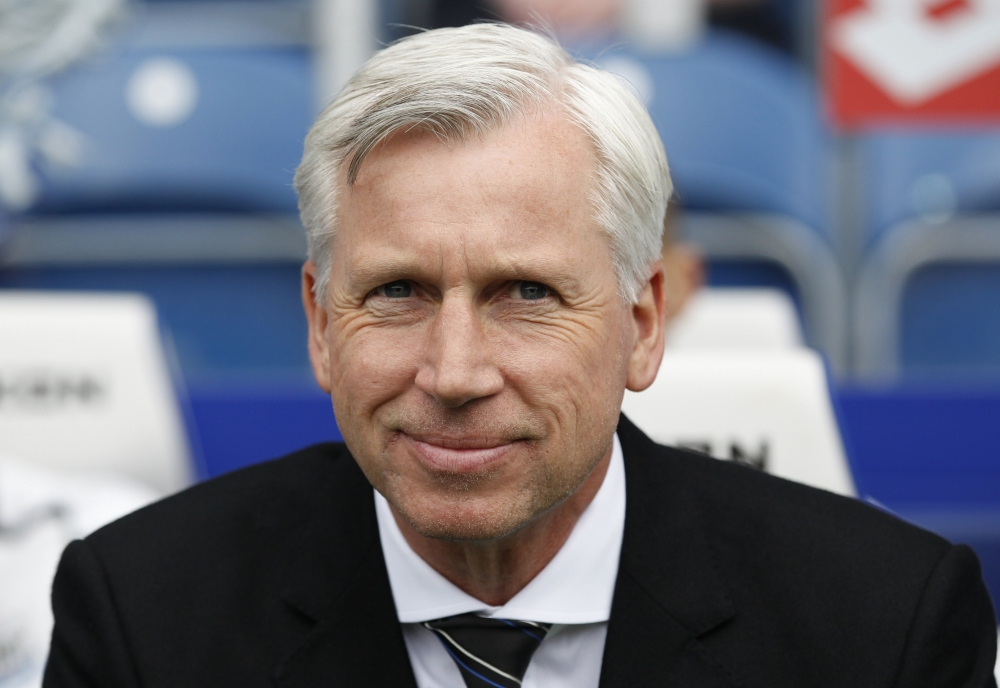 Newcastle United's English Manager Alan Pardew awaits kick off of the English Premier League football match between Queens Park Rangers and Newcastle United at Loftus Road in London on May 12, 2013. AFP PHOTO / IAN KINGTON  RESTRICTED TO EDITORIAL USE. No use with unauthorized audio, video, data, fixture lists, club/league logos or ìliveî services. Online in-match use limited to 45 images, no video emulation. No use in betting, games or single club/league/player publicationsIAN KINGTON/AFP/Getty Images