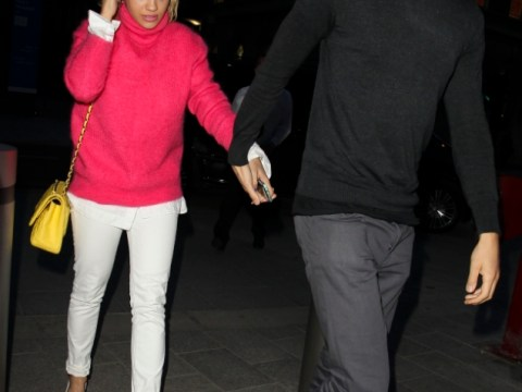 Rita Ora and Calvin Harris confirm relationship by kissing and holding hands at party