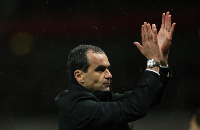 Wigan Athletic's Manager Roberto Martinez applauds the traveling fans as his side are relegated after the Barclays Premier League match at the Emirates Stadium, London. PRESS ASSOCATION Photo. Picture date: Tuesday May 14, 2013. See PA story SOCCER Arsenal. Photo credit should read: Stephen Pond/PA Wire. RESTRICTIONS: Editorial use only. Maximum 45 images during a match. No video emulation or promotion as 'live'. No use in games, competitions, merchandise, betting or single club/player services. No use with unofficial audio, video, data, fixtures or club/league logos.