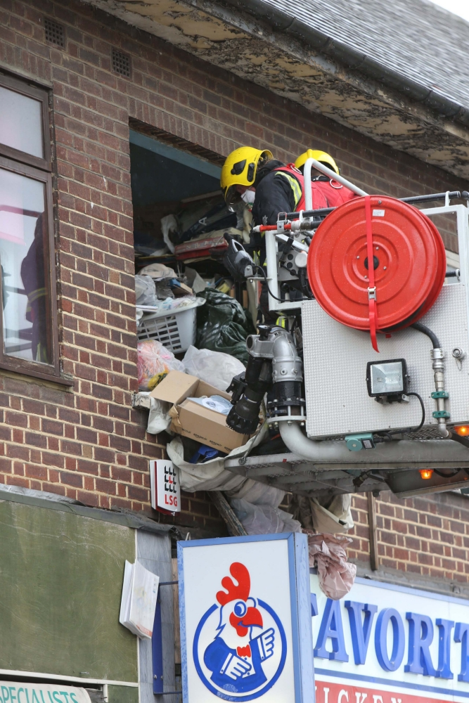 Hoarder rescued through 1st floor window after blocking up front door with rubbish
