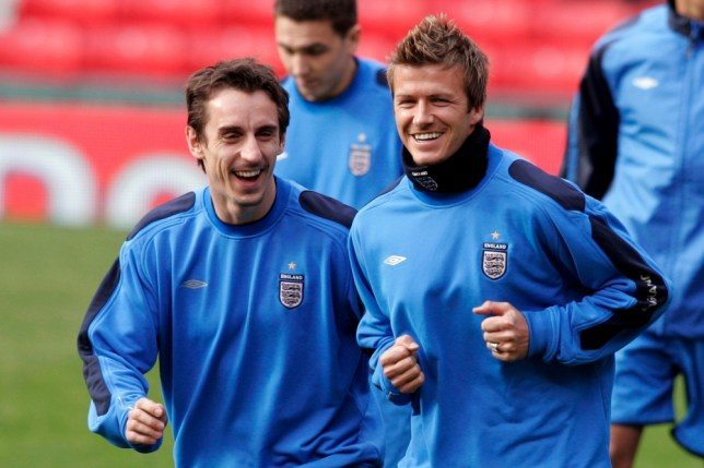 File photo dated 25/03/2005 of England's Gary Neville (left) sharing a joke with David Beckham during a training session. PRESS ASSOCIATION Photo. Issue date: Thursday May 16, 2013. Former England captain David Beckham will retire from football at the end of the season, the player's representative has confirmed. See PA Story SOCCER Beckham. Photo credit should read: Phil Noble/PA Wire.