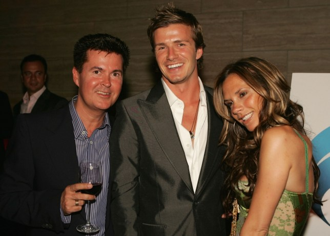 """BEVERLY HILLS, CA - JUNE 03:  (L to R) Co-founder of 19 Entertainment and creator of the """"American Idol"""" Simon Fuller, England and Real Madrid football player David Beckham and wife Victoria pose at """"The David Beckham Academy"""" launch party at Creative Artists Agency on June 3, 2005 in Beverly Hills, California.  The reception was a celebration in the partnership between sports and entertainment AEG and Beckham, which has established the Los Angeles and London locations of the David Beckham Academy.  (Photo by Kevin Winter/Getty Images for AEG)"""