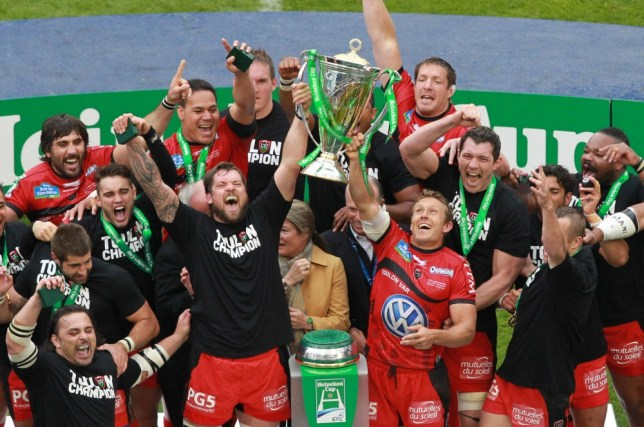 Toulon's Jonny Wilkinson (R) and team-mates lift the trophy after defeating Clermont 16-15 during the European Cup final between Clermont and Toulon at the Aviva Stadium in Dublin, on May 18, 2013 AFP PHOTO/ PETER MUHLYPETER MUHLY/AFP/Getty Images