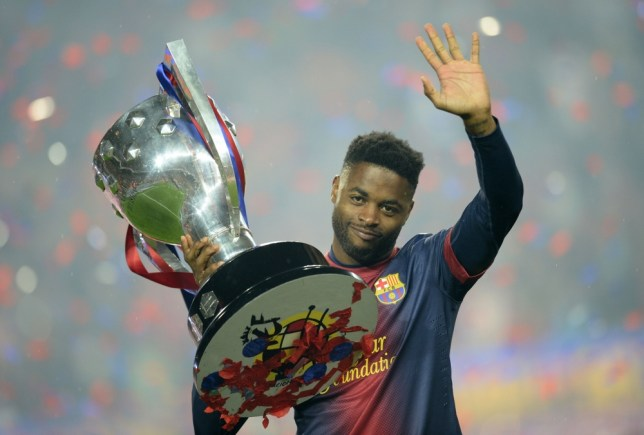 Barcelona's Cameroonian midfielder Alex Song celebrates during a ceremony at the Camp Nou stadium in Barcelona on May 19, 2013 after winning the Spanish League title. Barcelona celebrated lifting the La Liga trophy for a 22nd time with a 2-1 win over Valladolid. AFP PHOTO / LLUIS GENELLUIS GENE/AFP/Getty Images