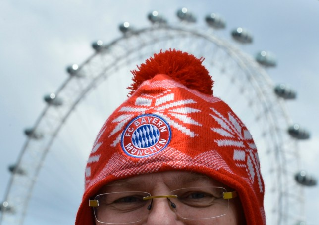A Bayern Munich supporter walks near the London Eye in central London May 25, 2013. The Champions League Final soccer match between Germany's Borussia Dortmund and Bayern Munich takes place at Wembley Stadium this evening. REUTERS/Toby Melville (BRITAIN - Tags: SPORT SOCCER TRAVEL)