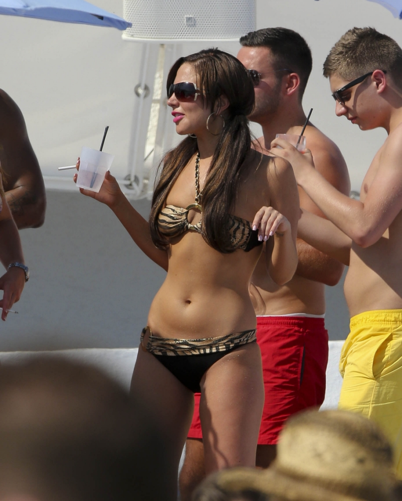 Tulisa puts Danny Simpson split behind her as she parties poolside in Marbella