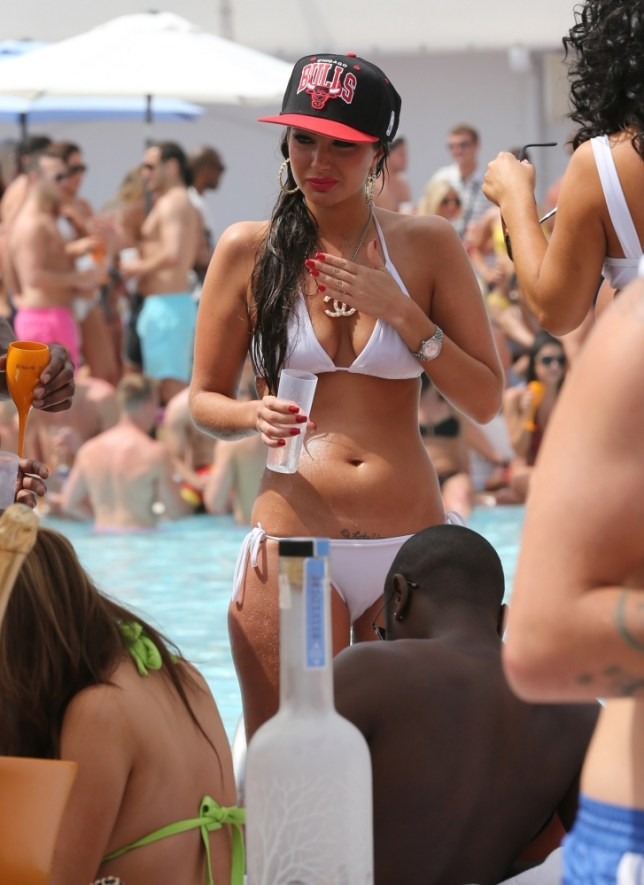 Is it someone's lucky day? Tulisa's 'secret' tattoo can be seen just above her bikini bottoms (Photo: Splash News)