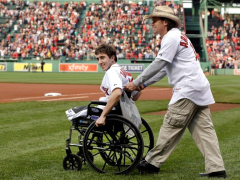 Man who lost both legs in Boston marathon bombing throws first pitch at Red Sox game