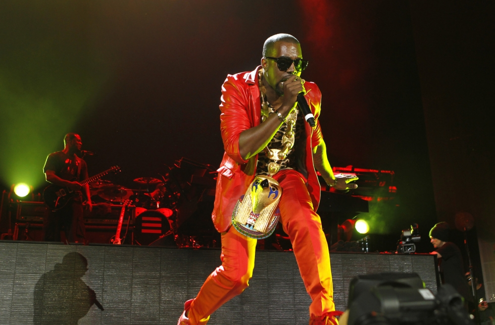 Kanye West makes a guest appearance during a Jay-Z concert at Yankee Stadium, Monday, Sept. 13, 2010, in New York.    (AP Photo/Jason DeCrow)