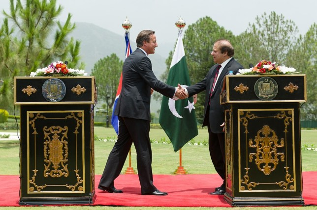 David Cameron shakes hands with Nawaz Sharif during a press conference in Islamabad, Pakistan. (Picture: Getty Images)