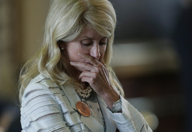 Wendy Davis reacts after she was called for a rules violation during her filibusters of an abortion bill (Picture: AP)