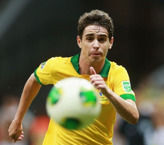 Battle: Oscar in action for Brazil after protests from demonstrators preceded the game in Brasilia (Picture: Getty Images)