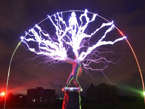 Guitarist creates 'lightning storm' during gigs by standing on Tesla coil