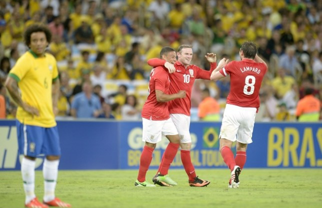 England's Wayne Rooney (centre) celebrates scoring their second goal of the game with team-mates Alex Oxlade-Chamberlain and Frank Lampard (right), as Brazil's Lucas Martins Fernando stands dejected during the International Friendly at the Maracana Stadium in Rio De Janeiro, Brazil. PRESS ASSOCIATION Photo. Picture date: Sunday June 2, 2013. See PA story SOCCER England. Photo credit should read: Owen Humphreys/PA Wire. RESTRICTIONS: Use subject to FA restrictions. Editorial use only. Commercial use only with prior written consent of the FA. No editing except cropping. Call +44 (0)1158 447447 or see www.paphotos.com/info/ for full restrictions and further information.