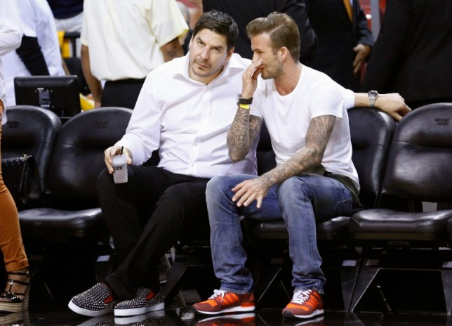 Former soccer player David Beckham (R) and Marcelo Claure, CEO of Brightstar, chat before Game 7 of the NBA Eastern Conference final basketball playoff between the Indiana Pacers and the Miami Heat in Miami, Florida June 3, 2013. REUTERS/Joe Skipper (UNITED STATES - Tags: SPORT BASKETBALL ENTERTAINMENT BUSINESS)