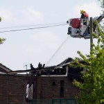 Firemen attend the scene of a fire at the Al-Rahma Islamic Centre in north London, June 5, 2013. Police have said that they are treating the fire as suspicious, local media reported.    REUTERS/Neil Hall (BRITAIN - Tags: CRIME LAW SOCIETY RELIGION)