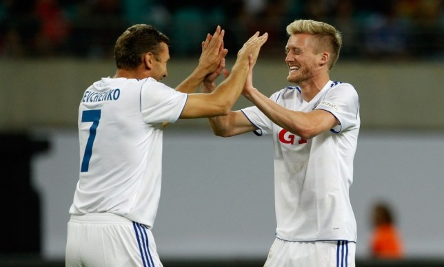 LEIPZIG, GERMANY - JUNE 05:  Andre Schurrle (R) of 'World Team' celebrates after scoring his team's third goal with team mate Andrij Shevshenko (L) during the Michael Ballack farewell match at Red Bull Arena on June 5, 2013 in Leipzig, Germany.  (Photo by Boris Streubel/Bongarts/Getty Images)