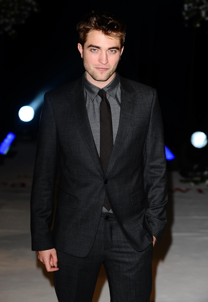 Robert Pattinson warned by management to stop his 'partying and womanising' ways