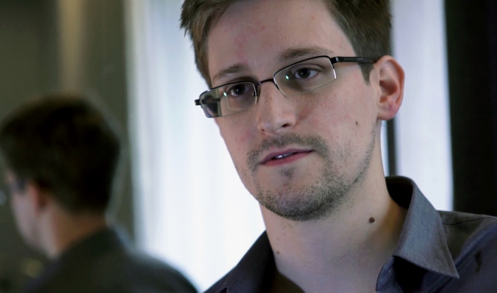 Edward Snowden leaves Moscow's Sheremetyevo Airport after being granted temporary refugee status in Russia