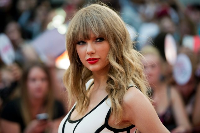 Taylor Swift poses on the red carpet during the 2013 MuchMusic Video Awards in Toronto on Sunday, June 16, 2013. (AP Photo/The Canadian Press, Nathan Denette)