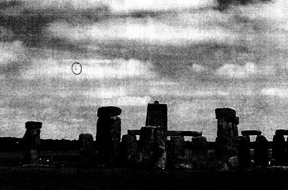 "Embargoed to 0001 Friday June 21.    BEST QUALITY AVAILABLE: Undated handout photo issued by The National Archives of a photograph apparently showing a 'UFO' by Stonehenge, Wiltshire, January 2009. The Ministry of Defence closed its UFO desk in 2009 because it served ""no defence purpose"" and was taking staff away from ""more valuable defence-related activities, newly-released files showed today. PRESS ASSOCIATION Photo. Issue date: Friday June 21, 2013. The latest tranche of declassified MoD UFO files showed that the decision was taken to close the desk and its UFO ""hotline"" in a year when sightings reported to the department had trebled, but that, in more than 50 years, none had indicated the existence of ""any military threat to the UK"". The 25 files, released today by the National Archives, include 4,400 pages and cover the work carried out in the last two years of the MoD's UFO desk, from late 2007 until November 2009. See PA story RECORDS UFO. Photo credit should read: The National Archives/PA Wire     NOTE TO EDITORS: This handout photo may only be used in for editorial reporting purposes for the contemporaneous illustration of events, things or the people in the image or facts mentioned in the caption. Reuse of the picture may require further permission from the copyright holder."