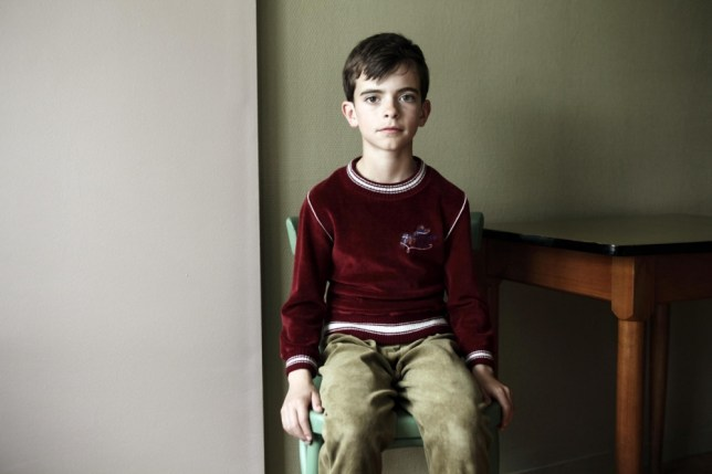 Victor from The Returned is giving nothing away, not even his attractive burgundy sweater (Picture: Jean-Claude Lother)