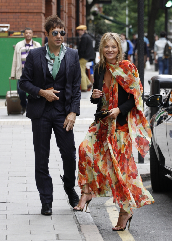 Kate Moss spends an awkward afternoon with old rival Sienna Miller at friend's wedding