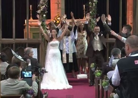 Vicar of disco: Flash mob breaks out in church as couple get married