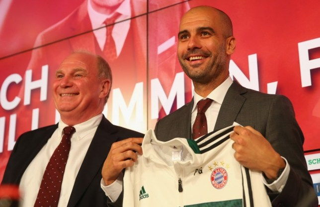 MUNICH, GERMANY - JUNE 24:  Josep Guardiola, new head coach of FC Bayern Muenchen, smiles with Uli Hoeness, President of FC Bayern Muenchen during his official presentation at the Allianz Arena on June 24, 2013 in Munich, Germany.  (Photo by Alexander Hassenstein/Bongarts/Getty Images)
