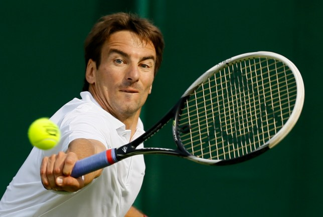 Tommy Robredo of Spain returns to Nicolas Mahut of France during their Men's second round singles match at the All England Lawn Tennis Championships in Wimbledon, London, Wednesday, June 26, 2013. (AP Photo/Kirsty Wigglesworth)