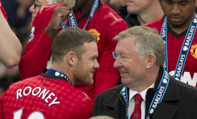Manchester United's manager Sir Alex Ferguson, right, speaks to striker Wayne Rooney