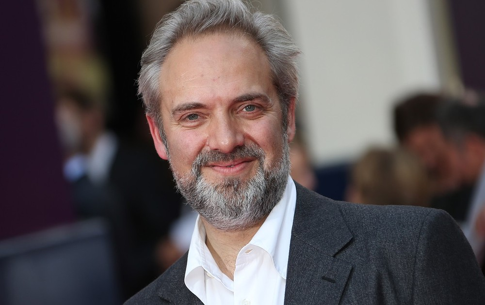 Director Sam Mendes arrives for the opening night of Charlie and the Chocolate Factory, a new stage musical based on Roald Dahl's popular story about Willy Wonka and his amazing Chocolate Factory, at the Drury Lane Theatre in central London, Tuesday, June 25, 2013. Joel Ryan/Invision/AP