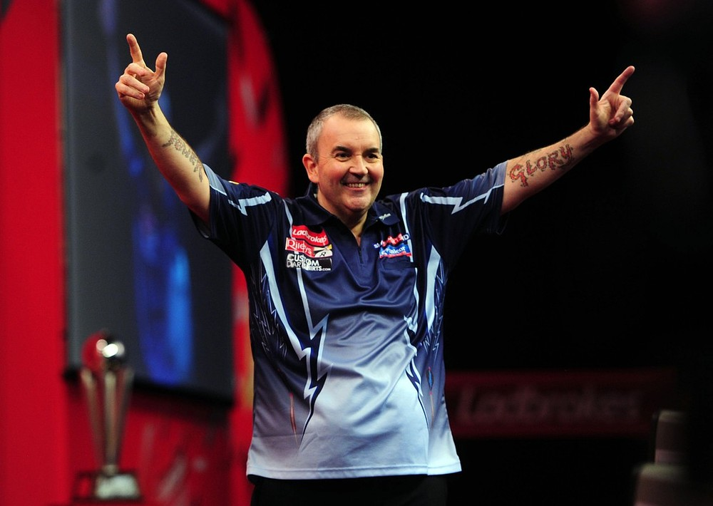 Phil Taylor wins his 14th World Matchplay title by surging past Adrian Lewis