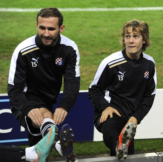 GNK Dinamo Zagreb's croatian midfielder Alen Halilovic (R) and teammate defender Ante Puljic stretch during a training session at Dragao Stadium in Porto on November 20, 2012 on the eve of the UEFA Champions League group A against Porto. AFP/Getty Images