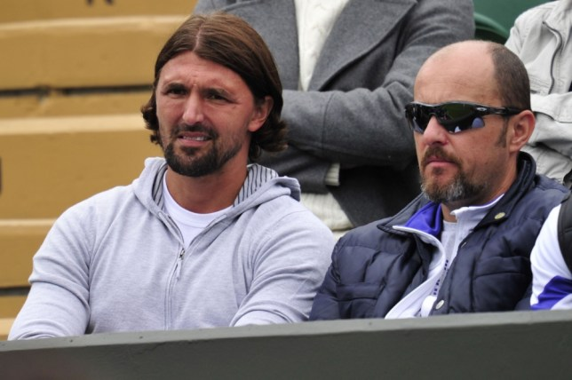 Retired Croatian tennis player Goran Ivanisevic watches the action on court 2 on day one of the 2013 Wimbledon Championships tennis tournament at the All England Club in Wimbledon, southwest London, on June 24, 2013. AFP PHOTO / GLYN KIRK -  RESTRICTED TO EDITORIAL USEGLYN KIRK/AFP/Getty Images