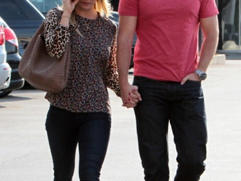 It's official! Henry Cavill and Kaley Cuoco are Hollywood's hot new couple as they hold hands during weekly shop