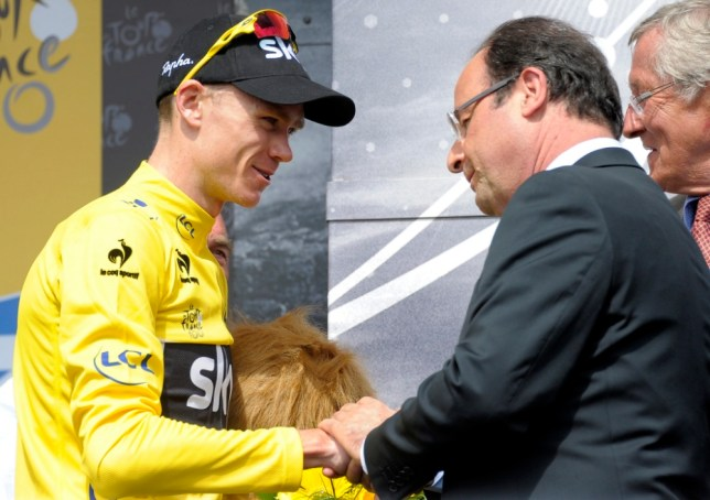 epa03779488 Sky procycling team rider Christopher Froome of Britain with the overall leader's yellow jersey (L) is congratulated by french president Francois Hollande (R) following the 9th stage of the 100th edition Tour de France 2013 cycling race between Saint-Girons and Bagneres-de-Bigorre, France, 07 July 2013.  EPA/NICOLAS BOUVY