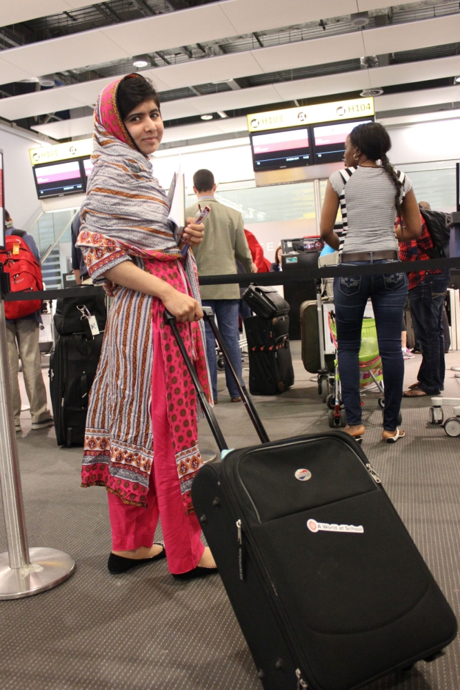 Handout photo issued by A World At School of Malala Yousafzai checks in at Heathrow Airport on her way to New York and a day of destiny at the United Nations. Malala, who was hunted down and shot by the Taliban as she sat on a school bus in Pakistan's Swat Valley last October, will address an historic gathering of over 500 young people from across the globe as they take over the UN and urge world leaders to find school places for 57 million girls and boys who currently have no access to education. PRESS ASSOCIATION Photo. Issue date: Monday July 8, 2013. Photo credit should read: A WORLD AT SCHOOL/PA Wire NOTE TO EDITORS: This handout photo may only be used in for editorial reporting purposes for the contemporaneous illustration of events, things or the people in the image or facts mentioned in the caption. Reuse of the picture may require further permission from the copyright holder.