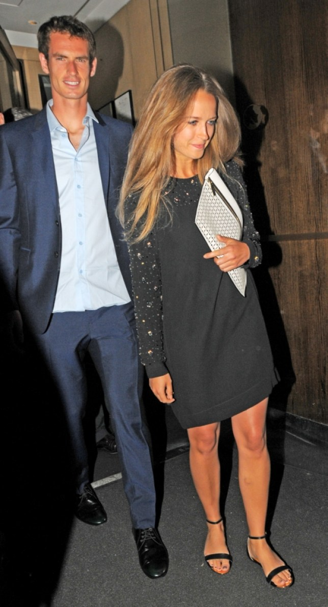 """9 July 2013 - LONDON - UK  ANDY MURRAY AND GIRLFRIEND KIM SEARS LEFT THE NOBU BERKELEY AFTER HAVING DINNER WITH SIMON FULLER TO A PACKED CROWD OF MEDIA AND PAPS, THEY WERE ESCORTED TO THERE CAR BY SECURITY BUT IN ALL THE FRENZY, ANDY MURRAY GOT """"SMASHED"""" IN THE EYE/FACE, IT LOOKED QUITE SORE AS HE GOT INTO THE CAR. BYLINE MUST READ : XPOSUREPHOTOS.COM  ***UK CLIENTS - PICTURES CONTAINING CHILDREN PLEASE PIXELATE FACE PRIOR TO PUBLICATION ***  **UK AND USA CLIENTS MUST CALL PRIOR TO TV OR ONLINE USAGE PLEASE TELEPHONE  44 (0) 208 370 0291 or 1 310 600 4723"""