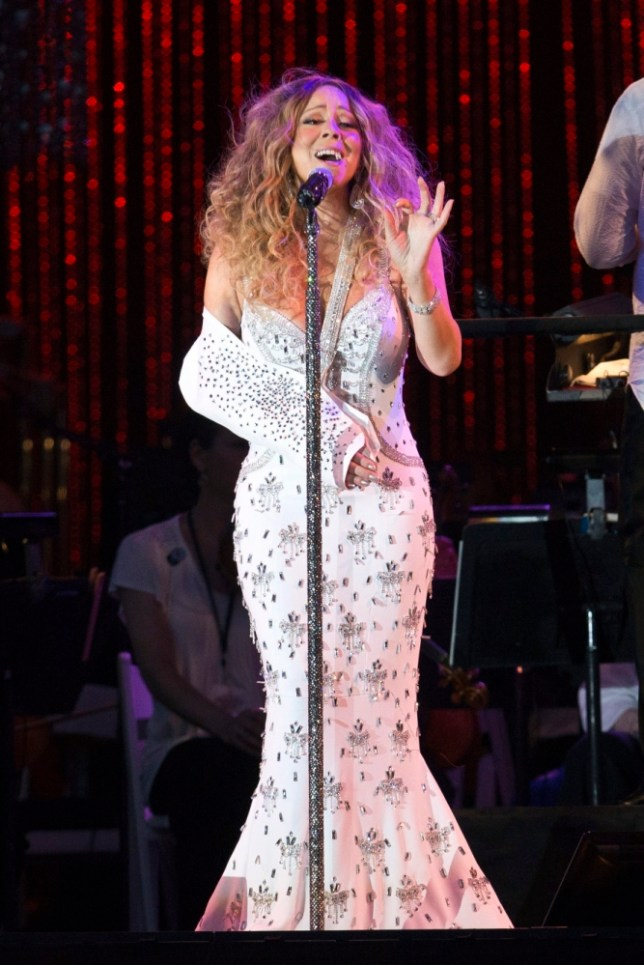 """Singer Mariah Carey wears a sling while performing with the New York Philharmonic at the Major League Baseball (MLB) All-Star Charity Concert benefiting Sandy Relief on the Great Lawn of Central Park in New York July 13, 2013. Carey was injured during the filming of the music video for her song """"#Beautiful."""" REUTERS/Andrew Kelly (UNITED STATES - Tags: ENTERTAINMENT)"""