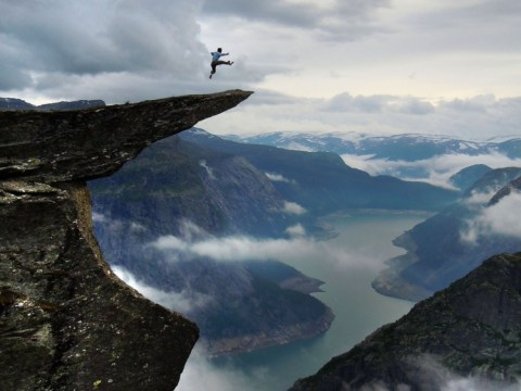 Postcards from the ledge: Daredevils caught on camera at 350m drop