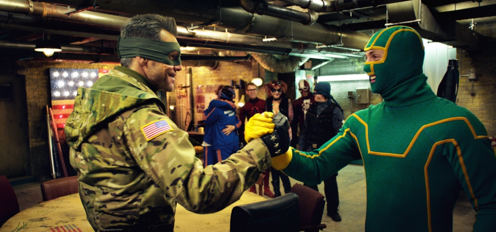 """This publicity photo released by Universal Pictures shows, Jim Carrey, left, as Colonel Stars and Stripes making a plan with Aaron Taylor-Johnson as Kick-Ass in a scene from the comedy film, """"Kick-Ass 2."""" (AP Photo/Universal Pictures)"""