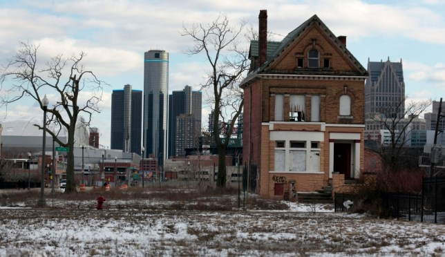 A vacant, boarded up house is seen in the once thriving Brush Park neighborhood with the downtown Detroit skyline behind it in Detroit, Michigan March 3, 2013. Michigan Governor Rick Snyder cleared the way for a state takeover of Detroit, declaring that the birthplace of the U.S. automotive industry faces a fiscal emergency and that he has identified a top candidate to assume its management. Friday's declaration by the Republican governor virtually assures that the state of Michigan will assume control of Detroit's books, and eventually decide whether the city should file the largest municipal bankruptcy in U.S. history.   REUTERS/ Rebecca Cook  (UNITED STATES - Tags: CITYSCAPE REAL ESTATE BUSINESS POLITICS) - RTR3EJDQ