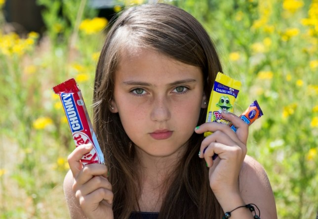 Holli McCann who was sent home from school trip for eating chocolate. See MASONS story MNCHOC: A primary schoolgirl was sent home from a end-of-term holiday by a headmistress because she was caught eating a 20p chocolate bar. Excited Holli McCann, 11, tucked into the forbidden treats with two Year 6 room-mates on the first night of the week-long break to the Isle of Wight. She described the secret snack in her first letter home which was read by teachers - even though it was in a sealed envelope. They immediately searched her room - removing the lining of her suitcase and tipping out her toilet bag - in the hunt for more chocolate.