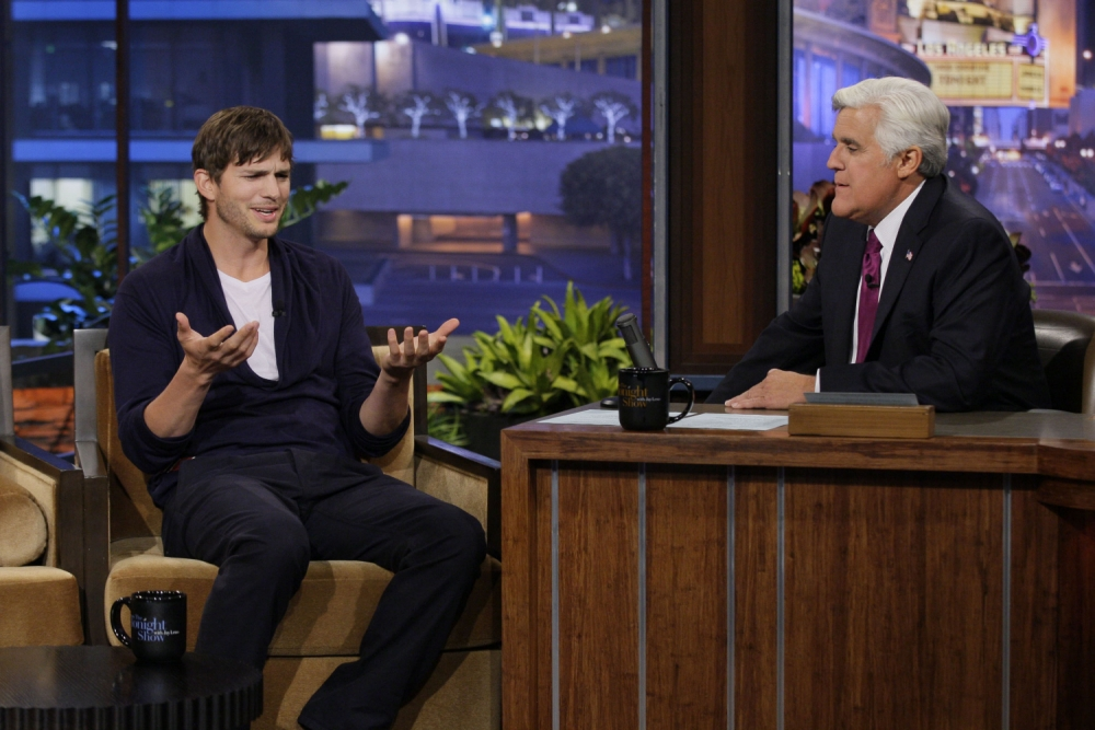 THE TONIGHT SHOW WITH JAY LENO -- Episode 4502 -- Pictured: (l-r) Actor Ashton Kutcher during an interview with host Jay Leno on July 24, 2013 -- (Photo by: Paul Drinkwater/NBC/NBCU Photo Bank via Getty Images)