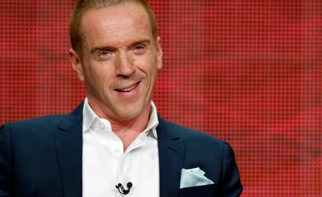 """Cast member Damian Lewis smiles at a panel for the television series """"Homeland"""" during the Showtime portion of the Television Critics Association Summer press tour in Beverly Hills, California July 29, 2013.   REUTERS/Mario Anzuoni  (UNITED STATES - Tags: ENTERTAINMENT)"""