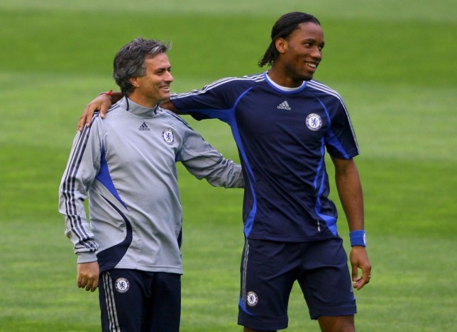 Chelsea Coach Jose Mourinho (L) shares a joke with striker Didier Drogba  during Chelsea training and press conference ahead of tomorrow's Champions League Quarter Final Second Leg match against Valencia, at the Stadium Mestalla on April 9, 2007 in Valencia, Spain.  (Photo by Stu Forster/Getty Images)